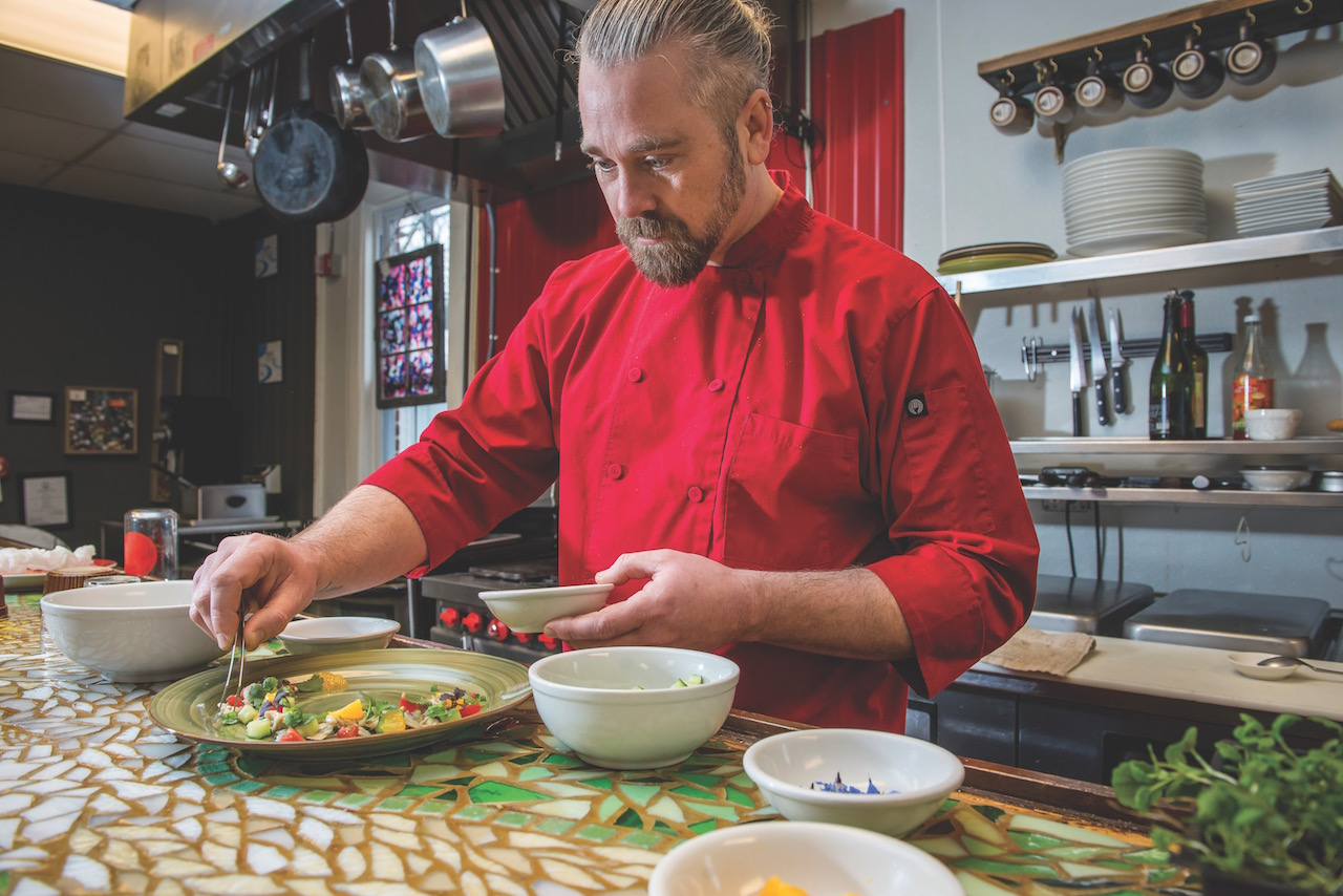 Chef Jason Van Marter of the Local putting together a dish